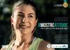 """O cartaz mostra uma mulher jovem que parece ter praticado atividade física ao ar livre (rosto suado e fone de ouvido) e traz como slogan """"#MostreAtitude. Sem o cigarro sua vida ganha mais saúde""""."""