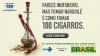 """Cartaz com imagem de um narguilé com detalhes em vermelho repleto de guimbas de cigarros me dizeres """"Parece inofensivo, mas fumar narguilé é como fumar 100 cigarros"""""""