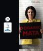 Na cartaz a Malga Di Paula, viúva de Chico Anysio, segura um cartaz e nele está escrito O cigarro mata.